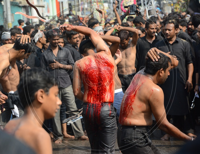 Muslims flagellate themselves in a procession to mark Ashoura during Muharram
