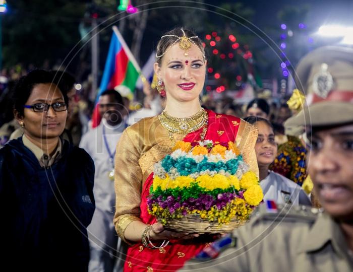Foreigners clad in traditional attire danced around Bathukammas in Hyderbad