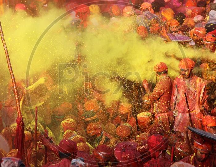 People Celebrating Holi Festival in Nandgaon