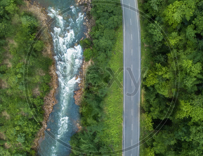 Aerial View of Water flowing and Road
