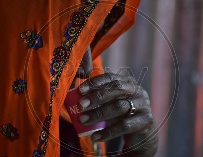 Rajasthani Woman in Traditional Attire Drinking Coffee at Pushkar Camel Fair