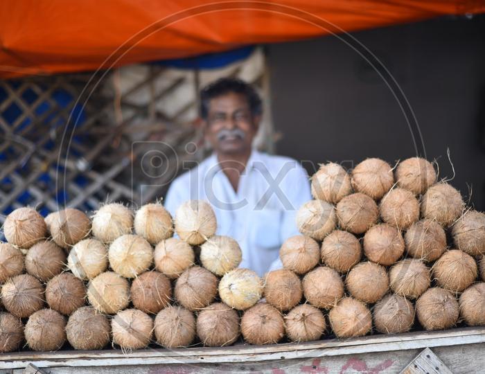 Coconut Seller at Local Vegetable Market/Rythu Bazar