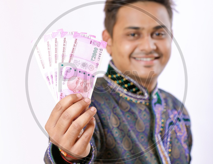 Indian Happy Businessman Holding Money in His Hands On an isolated White background