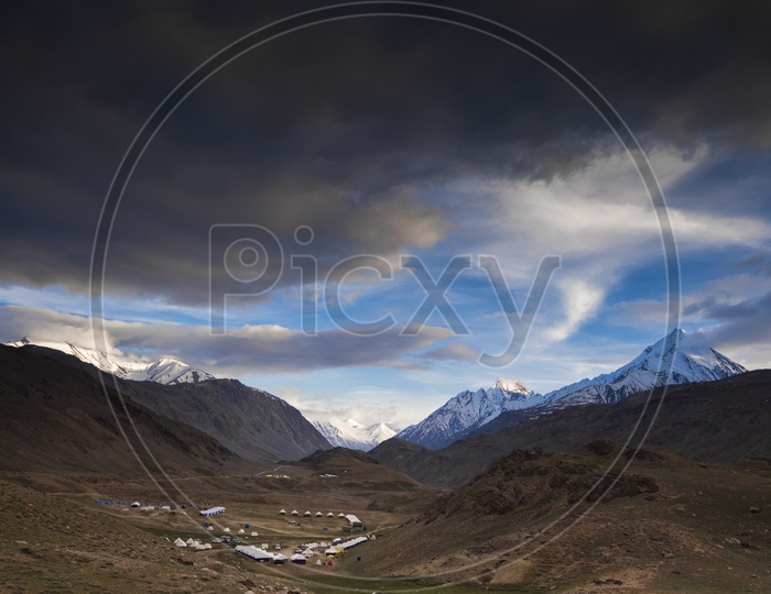 A River Valley Views Of Leh / Ladakh with Clouds and Mountains in Backdrop