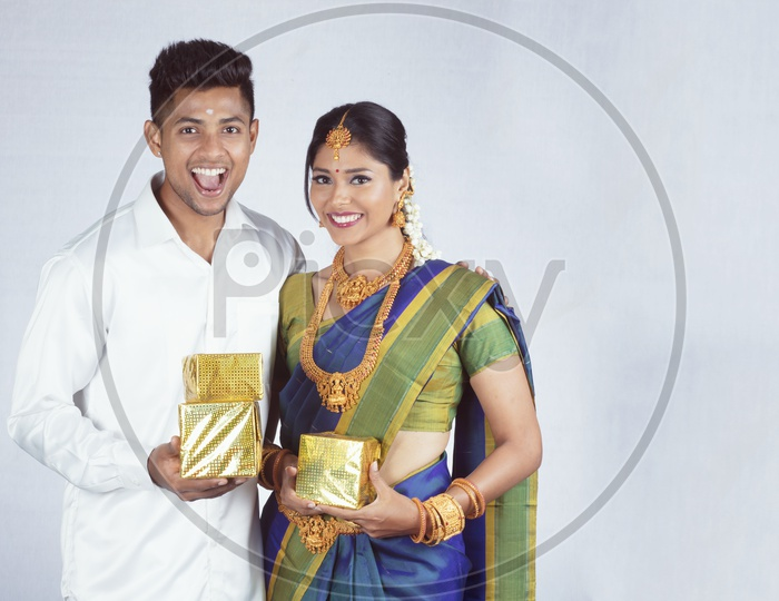 Traditional Indian Couple with Gifts- Man/Male, Female/Woman Models - White background
