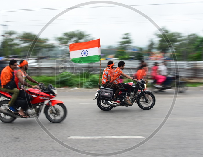 Pilgrims Travelling By Bikes With Indian Flag in Haridwar