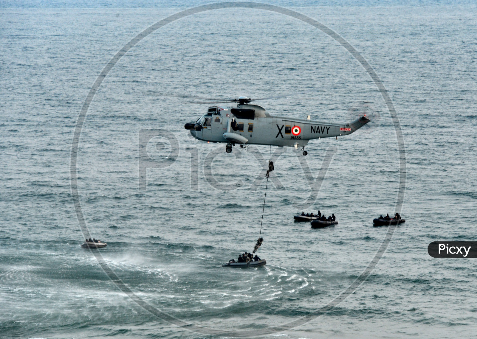 Indian Navy Sea King Helicopter Deploying Troops into Sea