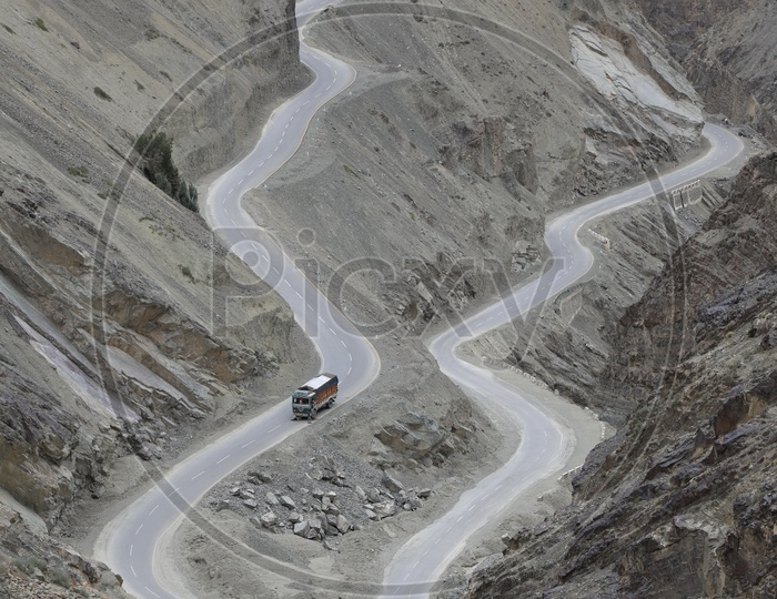Roadways of Leh with Beautiful Mountains / Lorry traveling on Leh roads