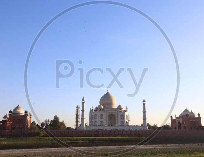 Beautiful View Of Taj Mahal With a Sunset and Blue Sky In Background