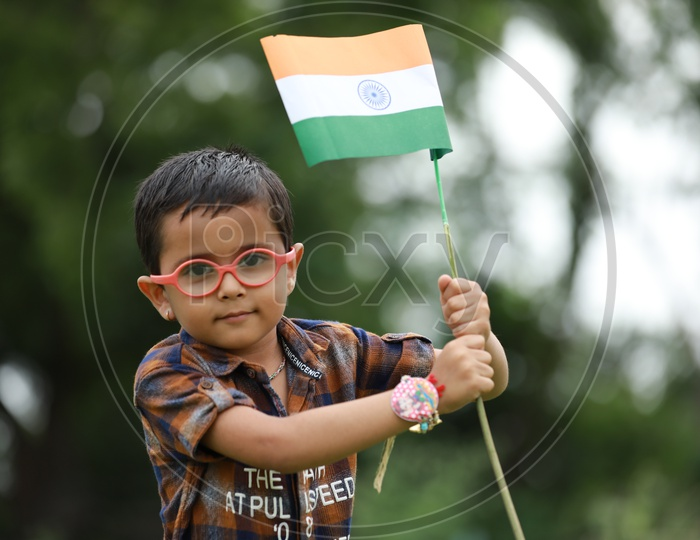 cute little kid having indian flag in hand  / indian flag / nation india