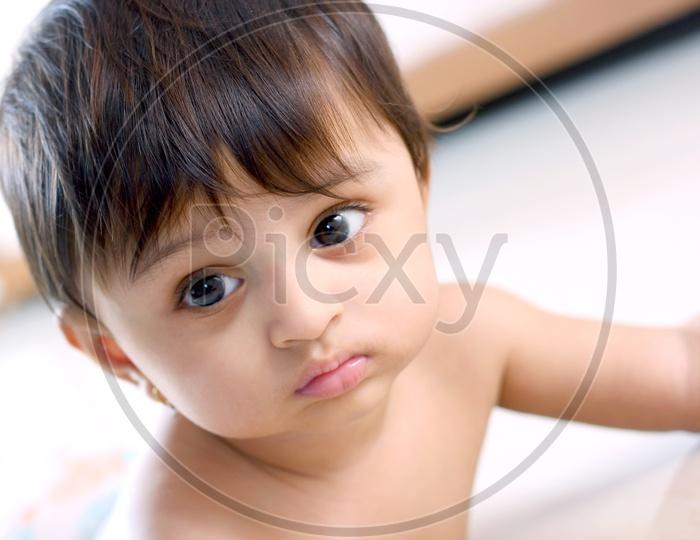 Cute baby girl looks sad
