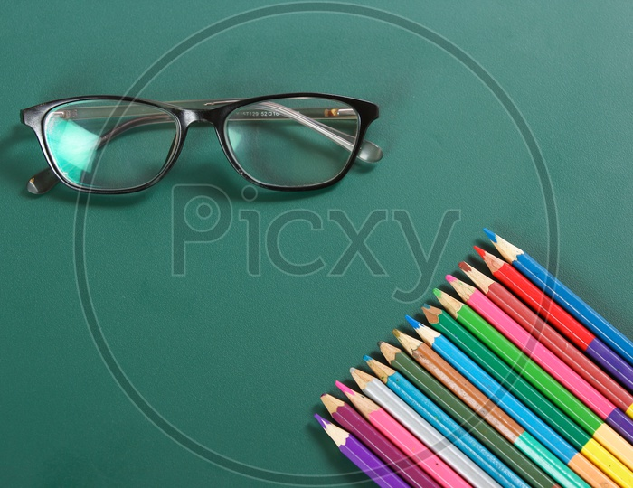 Happy Teacher Day Concept, Eye wears and Pencils