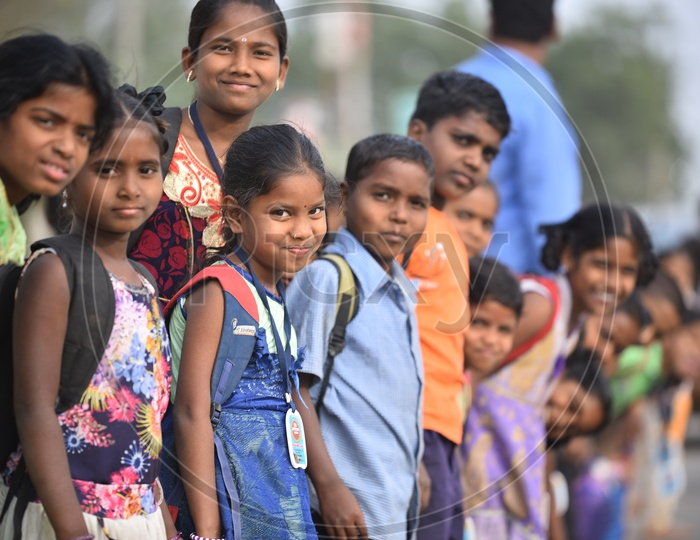 Indian School Children With Bags Waiting For Bus In Kosgi