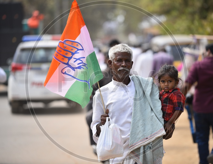 An Old Man Carrying His Grand Child Spotted in Election Rally With a Congress Flag in His Hand  in Tandur