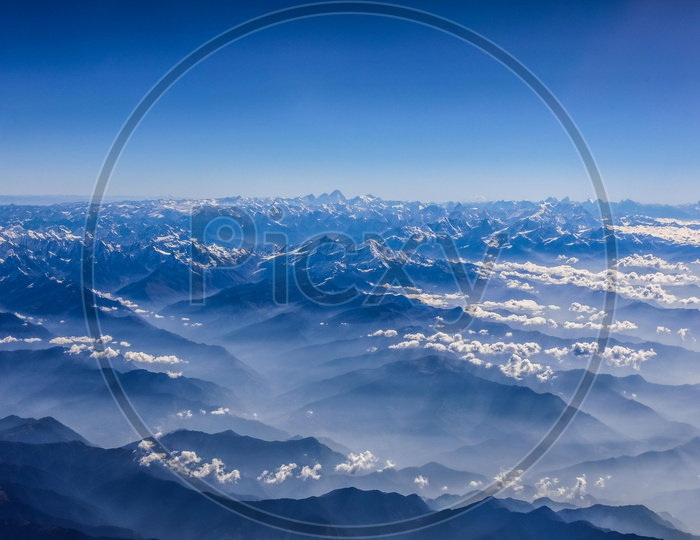 Clouds over Snow capped Mountains of Himalayas
