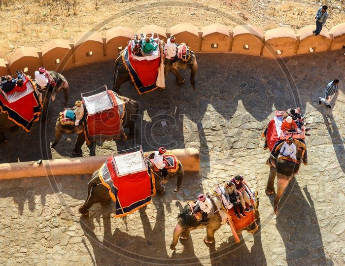 Tourists riding atop Elephants in Amer Fort