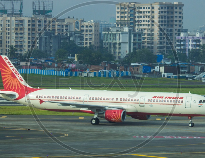 Air India A321 turning onto taxiway after completing its flight from chennai to mumbai.