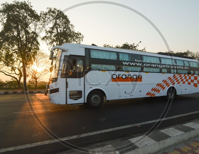Orange Travels Bus