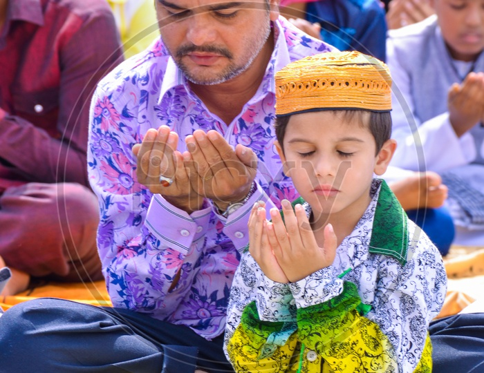 Father and Son offering prayers during Eid