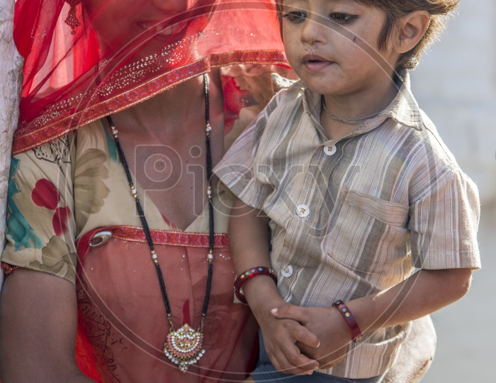 Smiling Rajasthani Woman with her Son in Traditional Attire