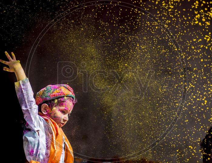Child celebrating Holi Festival in Nandgaon, Brij Mathura