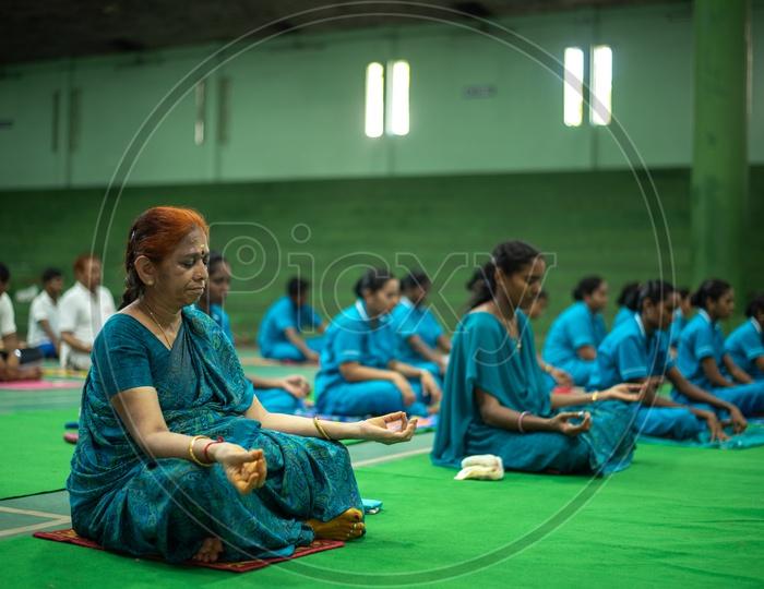 A senior/elder woman practising Yoga. International Yoga Day, 2018