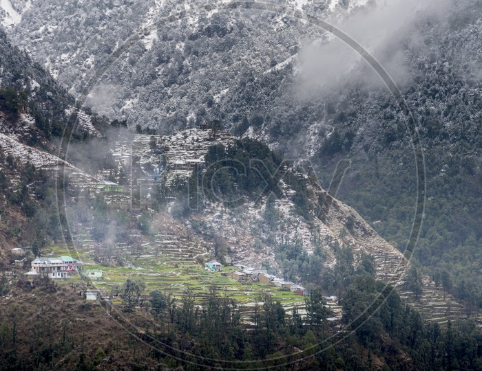 Village Surrounded by Snow Capped Mountains at Dharmasala, Himachal Pradesh