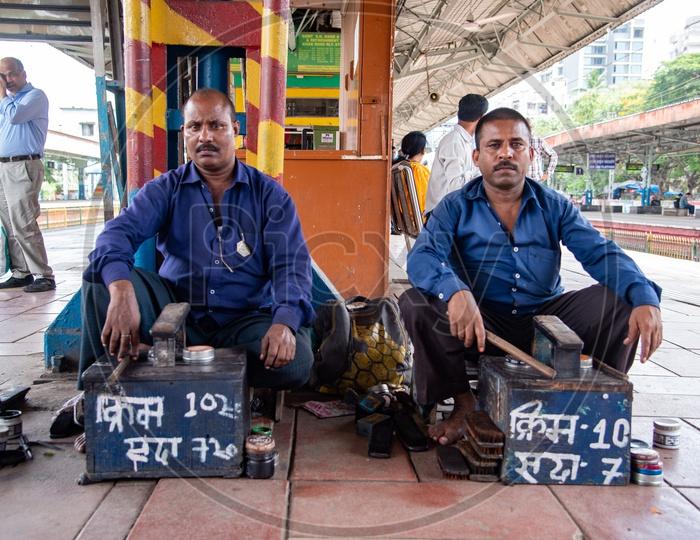 Shoe polishers / Cobblers at a subarban railway station in Mumbai