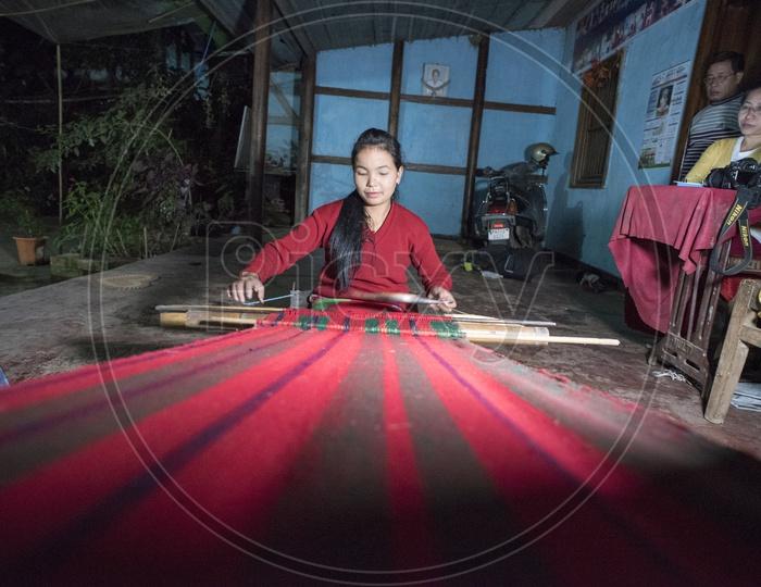 Girl Weaving a Saree near Loktak Lake, Manipur