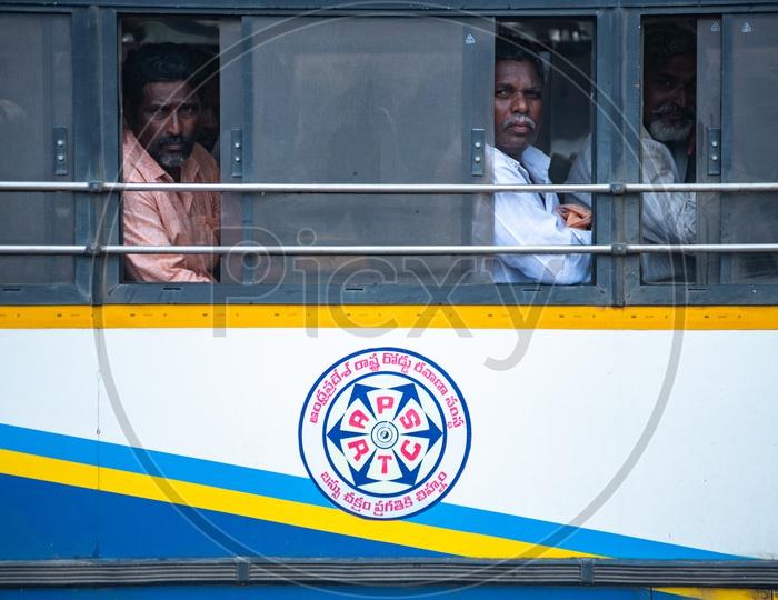 Passengers in an APSRTC Bus.