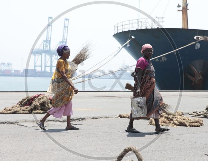 Women cleaners in a shipyard