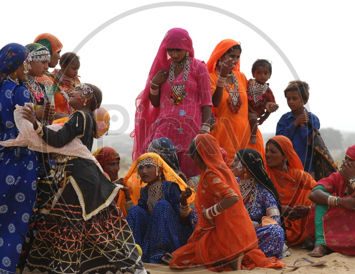 Indian women and kids in desert Rajasthan