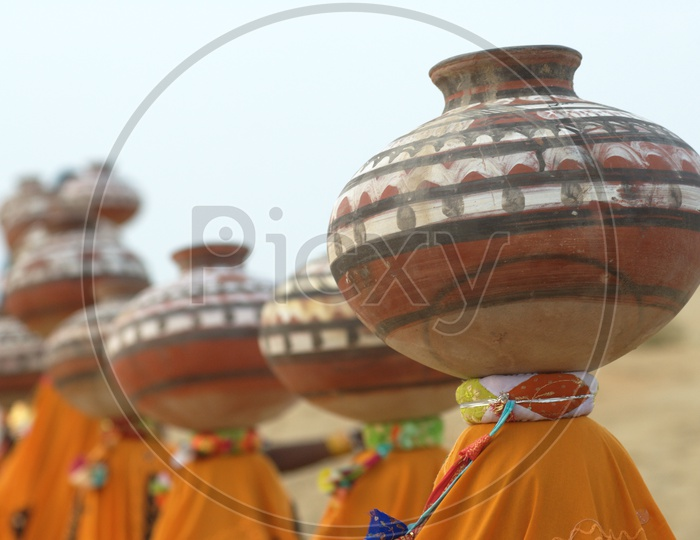 Indian Female with Pots in desert Rajasthan