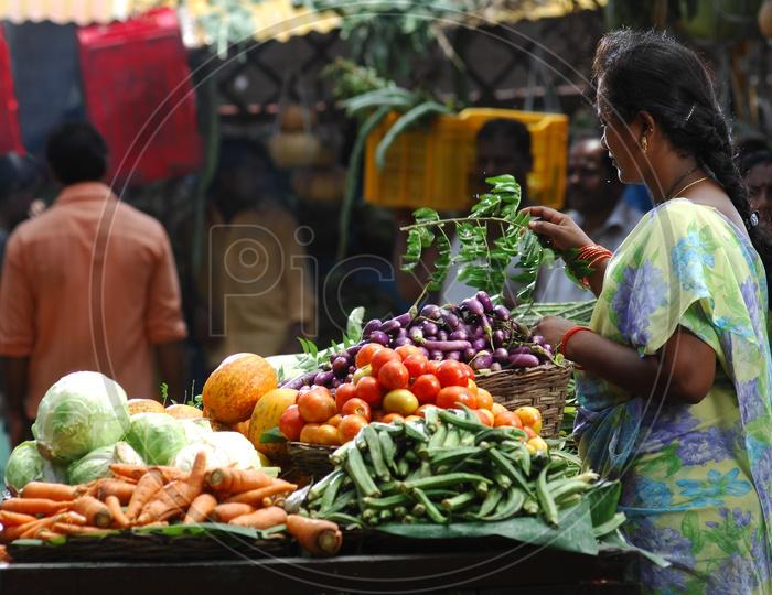 Female at vegetable shop