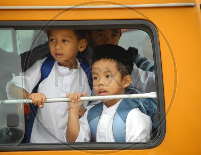 School Children From School Bus Window