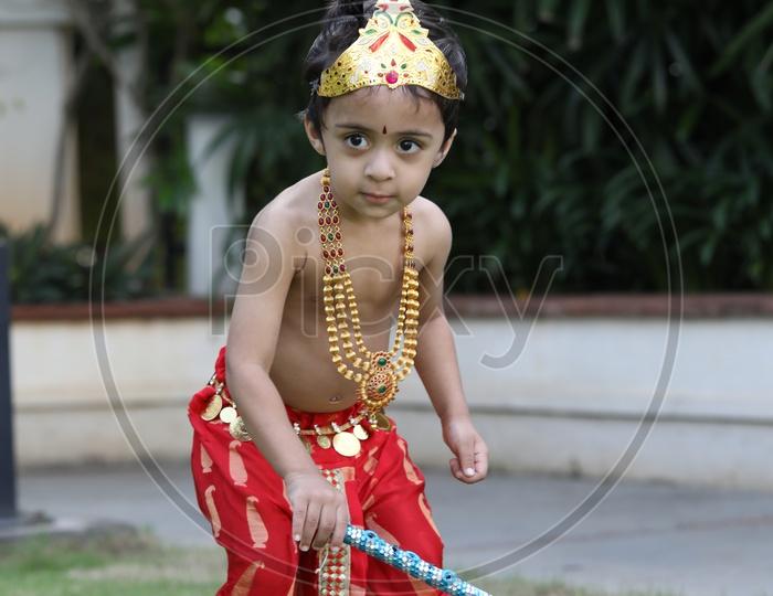 Little boy dressed up as Lord Krishna