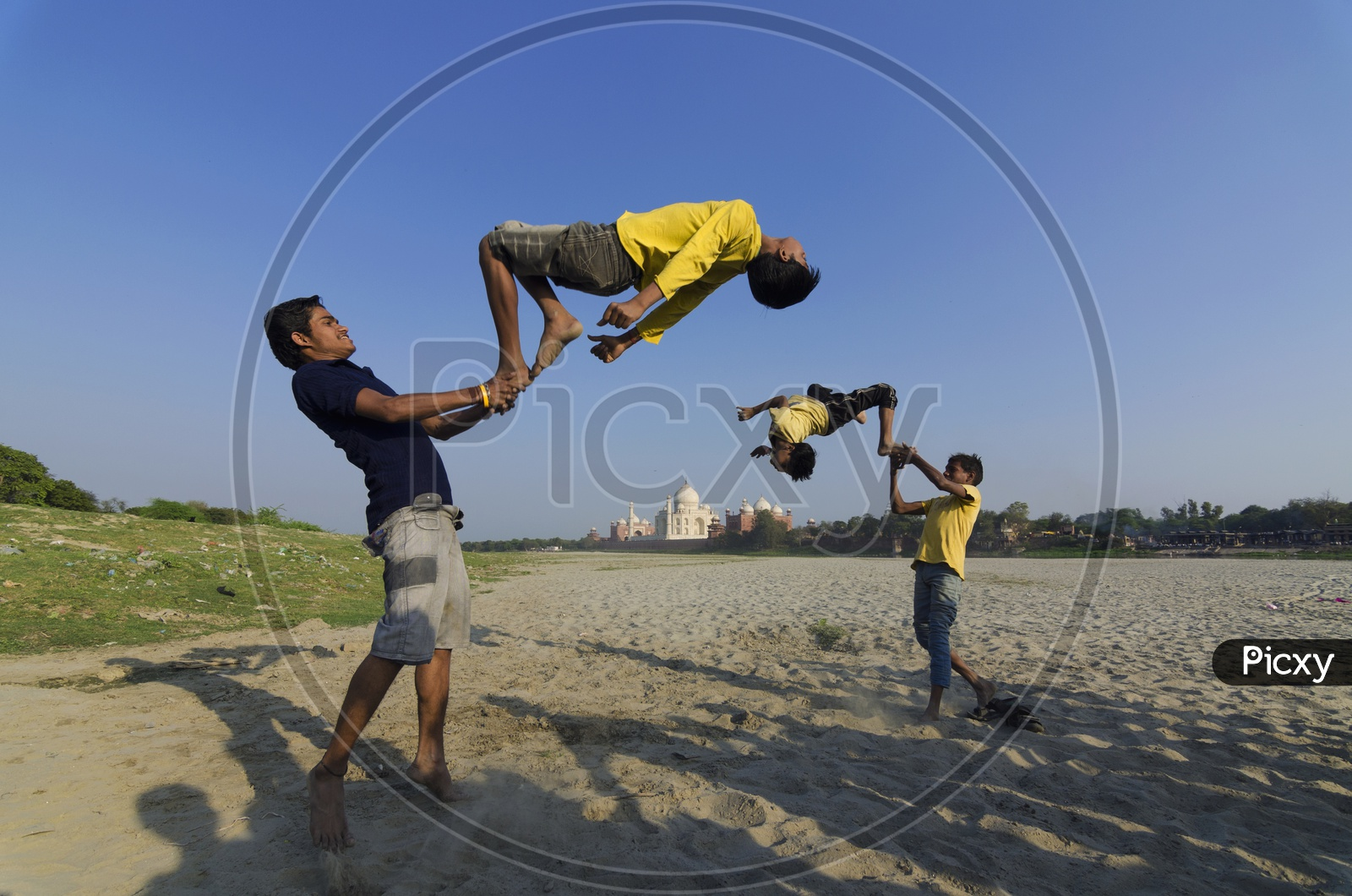 Guys doing stunts by jumping on a person