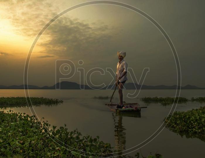 Fisherman sailing a small boat