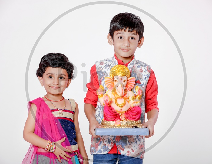 Indian Children with Lord Ganesh Idol