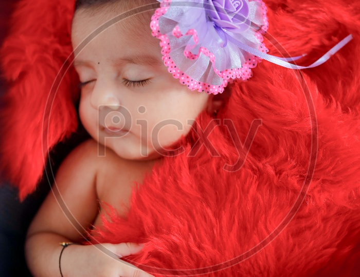 Indian Cute Baby Sleeping With A Cute  Expression on Face Closeup Shot