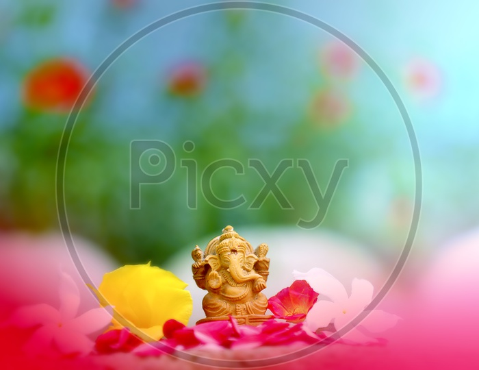 Beautiful photograph of Ganesh Idol with greenery in the background / Lord Ganesha