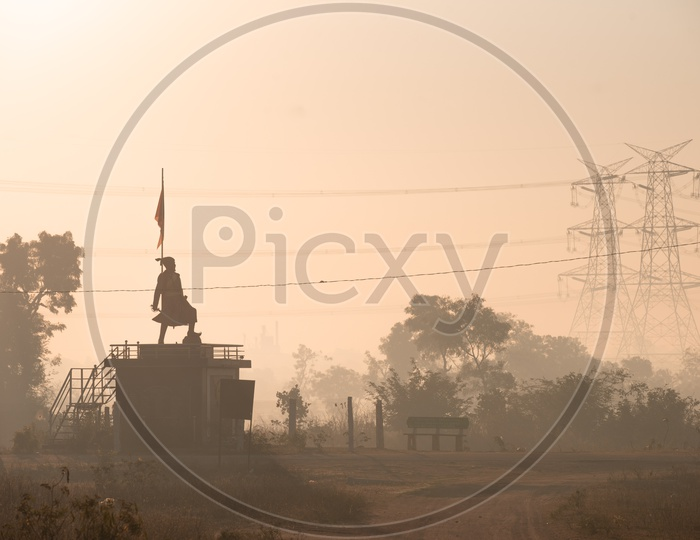 Chatrapathi Shivaji Statue in a Village on a Beautiful fog Background
