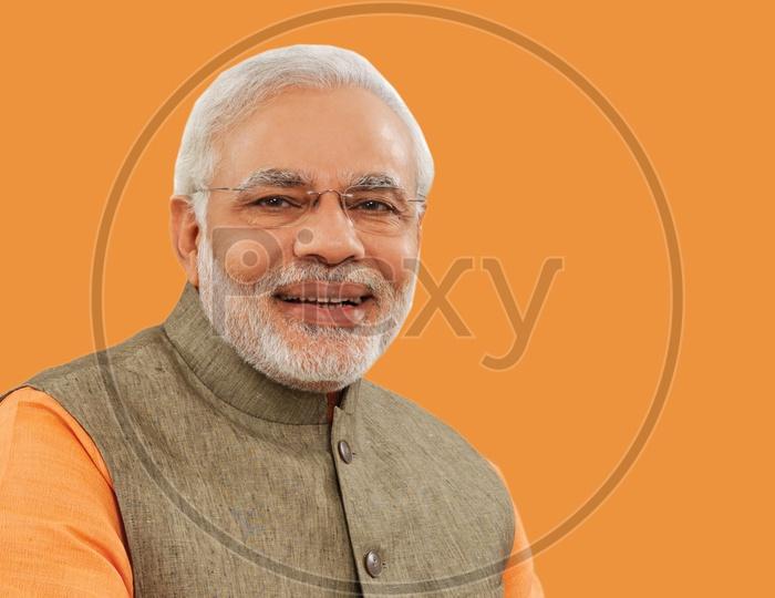 Closeup illustration shot of Narendra Modi, The 14th Prime Minister of India smiling with orange background