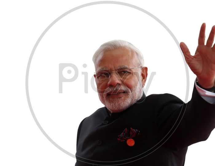 Narendra Modi, The Prime Minister of India waving his hand at supporters with white background
