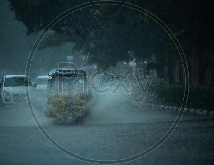 Auto on Flooded Road During Heavy Rain Near Hi-tech City