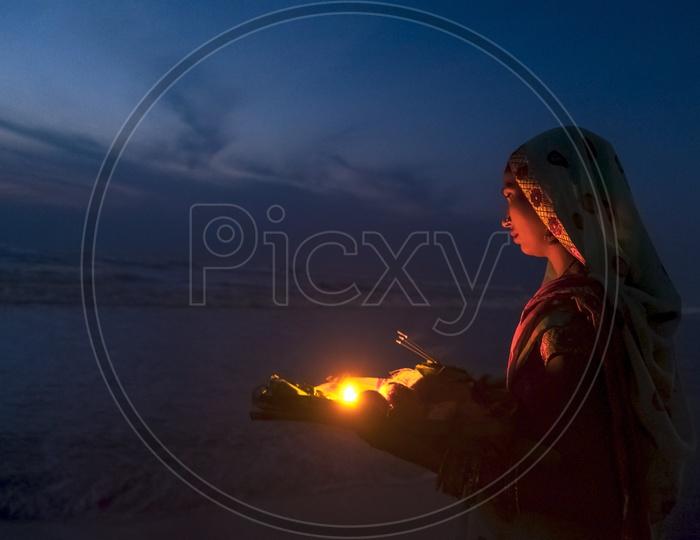 The first light & Chhath Puja devotee