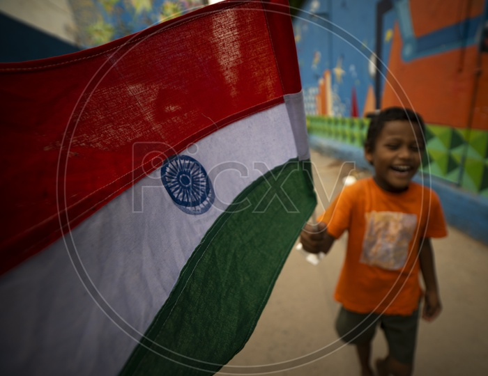 Indian Boy With Tricolour Indian National Flag