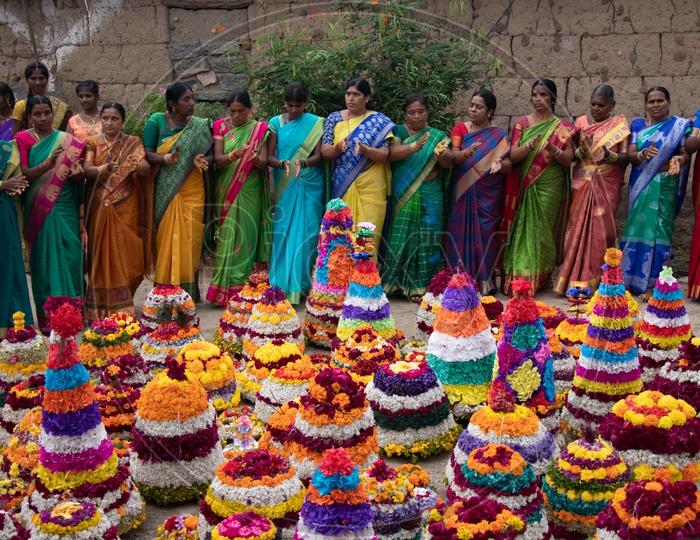 Telangana Woman Celebrating Saddula Bathukamma Festival By Singing Songs Around Floral  Placed In Middle At Rural Telangana Villages