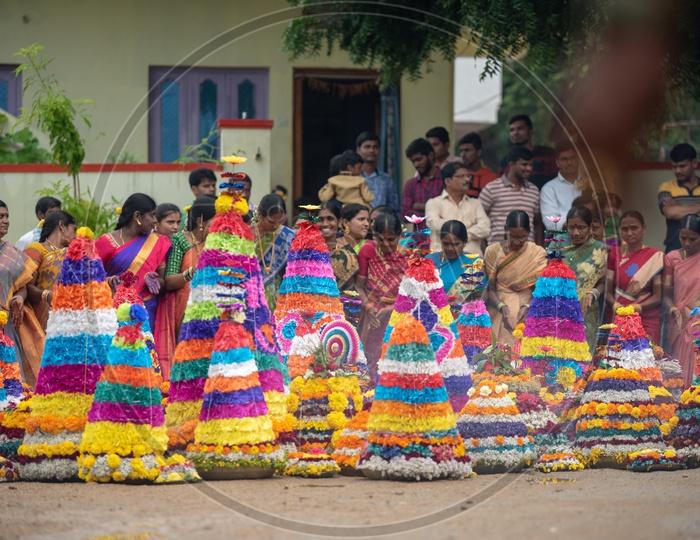 Women of Telangana celebrate Saddula Bathukamma(Pedda Bathukamma) by decorating flowers and dancing in front of them