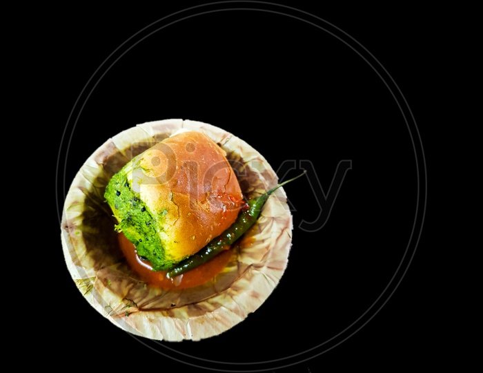 Vada Pau Bread And Green Sauce On A Plate In Dark Background